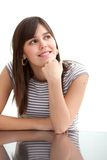 Girl leaning on a desk Royalty Free Stock Images