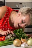 Girl leaning down and petting tortoise on its head next to big r. Oman salad Stock Images