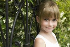 Girl Leaning On Fence Royalty Free Stock Images