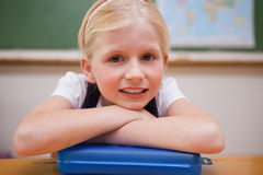 Girl leaning on her desk Royalty Free Stock Photos