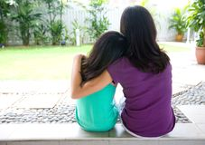 Girl leaning on her sister's shoulder for suppor royalty free stock photos