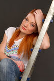 Girl leaning on a ladder Stock Photo