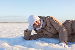 Girl is leaning on snow Stock Photos
