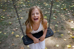 Girl leaning on swing Stock Photography
