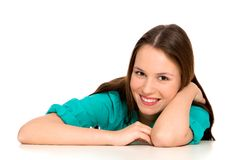 Girl leaning on table Stock Image