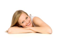 Girl leaning on table Stock Photo