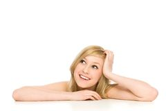 Girl leaning on table Stock Images