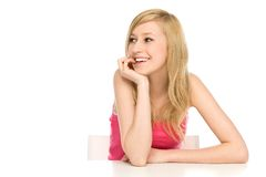 Girl leaning on table Royalty Free Stock Images