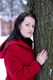 Girl leaning on tree Stock Images