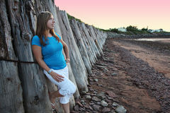 Girl Leaning on Wall royalty free stock image