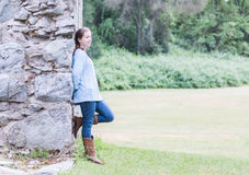 Girl Leaning on Wall Royalty Free Stock Images