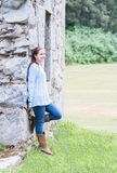 Girl Leaning on Wall Stock Photography