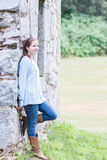 Girl Leaning on Wall Royalty Free Stock Photo