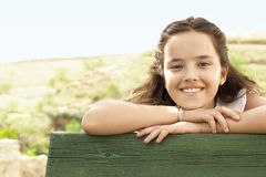 Girl Leaning On Wooden Railing Stock Images