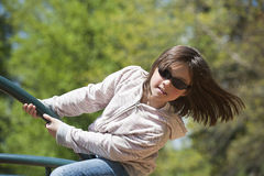 Girl leans out on ride. Royalty Free Stock Photo