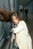 Girl leans on the rail Stock Photos