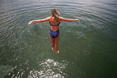 Girl Leaping into Water Royalty Free Stock Photo