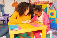 Girl learn alphabet in early development class royalty free stock photo