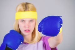 Girl learn how defend herself. Woman exercising with boxing gloves. Boxing sport concept. Cardio boxing exercises to stock photos