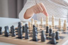A girl learn how to play chess game. With her dad royalty free stock photography