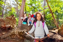 Girl learn orientation in forest on summer holiday royalty free stock photography