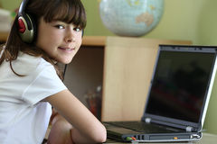Girl learning. Yong girl learning using laptop Royalty Free Stock Photography