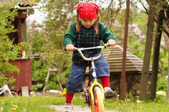 Girl learning drive bicycle Royalty Free Stock Photos