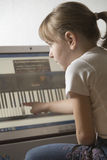 Girl Learning Keyboard On Computer At Home Royalty Free Stock Photos