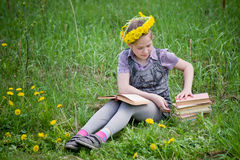 Girl learning in meadow Royalty Free Stock Photos