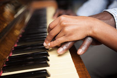 Girl learning play piano with her dad Royalty Free Stock Photo