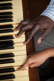 Girl learning play piano with her dad Stock Photos
