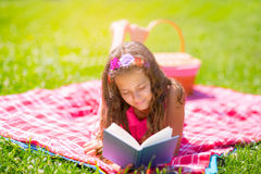 Girl learning on summer vacation and reading book Royalty Free Stock Photo