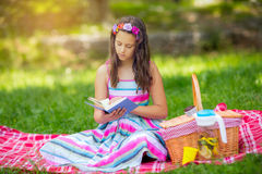 Girl learning on summer vacation and reading book Stock Photos