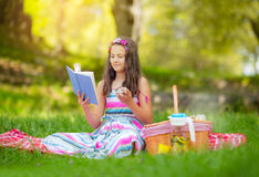 Girl learning on summer vacation and reading book Stock Photo