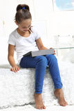 Girl learning on the tablet Royalty Free Stock Images
