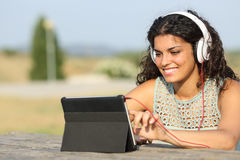 Girl learning with a tablet outdoors Royalty Free Stock Photo