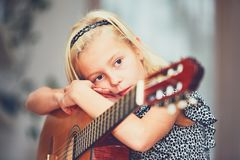 Girl learning to play to the guitar Stock Image