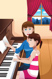 A girl learning to play a piano Stock Photography
