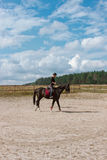 Girl learning to ride horse Royalty Free Stock Photography