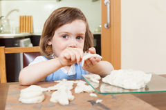 Girl learning to sculpt dough figurines Stock Photos