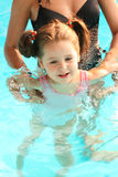 Girl learning to swim. Small girl learning to swim Royalty Free Stock Image