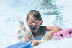 Girl learning to swim Royalty Free Stock Photography