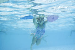 Girl learning to swim Royalty Free Stock Images