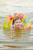 Girl learning to swim in lake Stock Image