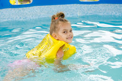 Girl learning to swim in the pool Royalty Free Stock Photography