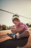 Girl learning to tie shoelaces Stock Photos