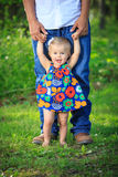 Girl learning to walk with dad Stock Photography