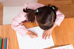 Girl learning to write Stock Photography