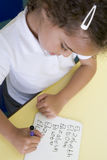 Girl learning to write name in primary class Royalty Free Stock Photos
