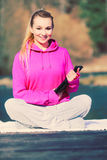 Girl learning yoga from tablet. Royalty Free Stock Images